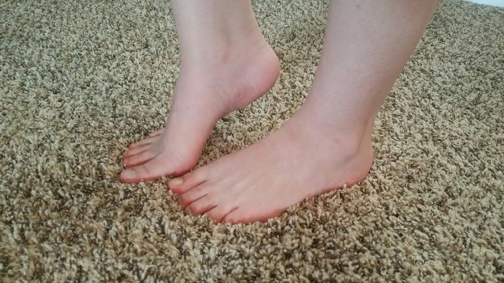 Feet touching the carpet fibers
